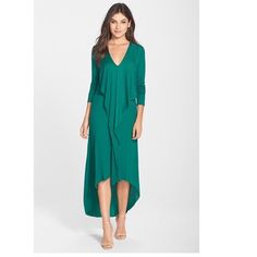 BCBGMAXAZRIA 'crissie' cascade front dress This dress is beautiful! It just doesn't fit me! Pretty jewel green in color it features v neck, long sleeve, cascading draped front overlay, shift dress silhouette, high low hemline. Longest part of front is 45 1/2 inches, longest part at back is almost 57 inches. Measurements taken while dress was hanging. Unlined. New with tags. 96% lyocell 4% spandex. PRICE IS FIRM! BCBGMaxAzria Dresses High Low