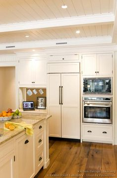 #Kitchen Idea of the Day: A gallery of classic white kitchens. (By Crown Point Cabinetry). Lovely paneled refrigerator.