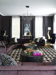 Elegant and welcoming living room with velvet sectional sofa. The colour choice of a soft purple adds luxury and warmth while the geometric patterned rug adds personality - Greg Natale's Book – The Tailored Interior