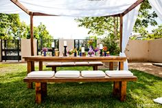 Outdoor, casual, classy, wooden benches, white cushions and drapes, candles, florals, romantic, pops of vibrant colors Lauren Sharon Vintage Rentals and Design