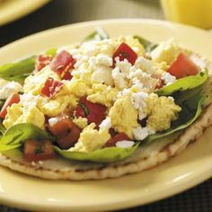 Mediterranean Breakfast Pitas    Ingredients:  •1/4 cup chopped sweet red pepper  •1/4 cup chopped onion  •1 cup egg substitute  •1/8 teaspoon salt  •1/8 teaspoon pepper  •1 small tomato, chopped  •1/2 cup torn fresh baby spinach  •1-1/2 teaspoons minced fresh basil  •2 whole pita breads  •2 tablespoons crumbled feta cheese