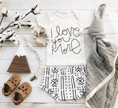 I love you More love quote | organic baby boy girl newborn clothes | figs and foxes made in USA | macrame pacifier clip | leather baby moccasins | organic cotton baby leggings harems shorts bloomers | wooden baby toys | chewable charm silicone wood teething toy | baby blanket | gender neutral nursery items | flatlay baby items shower gifts | mom to be | fall baby clothes | mudcloth