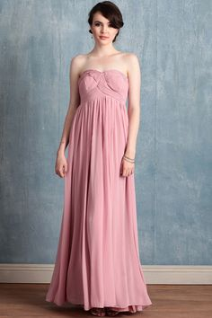 Reminiscent of origami folds, delicate ruched details lend artistry to this pink maxi dress in elegant georgette. Polished with a hidden back zipper closure and a flattering empire waist.
