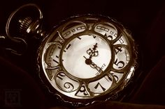 Taking a photo of my father's Pocket watch with the Sepia Tone mode turned on- on my camera. Would you believe that this photo was taken underneath a tree? (6-30-2016) By: Kevin P. (KJP Photography)