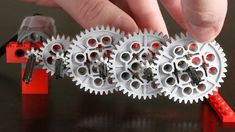 "Building a long gear train using 186 Lego gears. Many different types of Lego gears are used. Inspired by Daniel de Bruin's ""universe's biggest gear r."