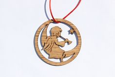 "This laser cut and engraved ornament is perfect for hanging on a tree or tying on a gift. Each ornament measures 1/8"" thick and about 3"" across. Add a date, a name, and/or your own short message (i.e."