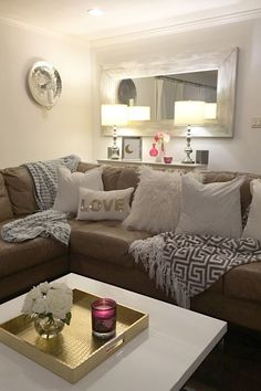 Bright and White, even at night! I love the brightness white textures bring to a space, day or night.  Pillows, throws and accessories from HomeGoods.  Sponsored Pin.