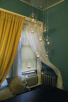 Hanging whirley glass tea lights