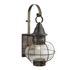 One-light outdoor wall lantern in gunmetal. Crafted of brass with an oval clear glass shade.Product: Wall lanternConstruction Material: Metal and glassColor: GunmetalFeatures: Made in the USAAccommodates: (1) 100 Watt incandescent Edison base bulb - not includedDimensions: 24.75 H x 14 W