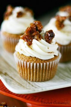 Pecan Pie Pumpkin Cupcakes filled with Pecan Pie Filling and topped with Cream Cheese Frosting - www.yummycrumble.com