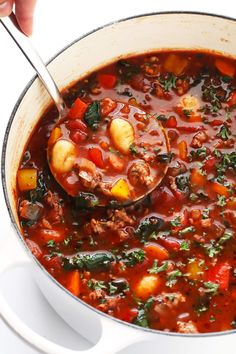 This Italian Sausage, Gnocchi and Tomato Soup recipe is SO cozy and delicious! It's filled with your choice of sausage (pork, chicken, turkey, or vegan), lots of veggies (bell peppers, onions, carrots, celery), lots of tomatoes, tender gnocchi (or diced potatoes), and topped with lots of Parmesan and fresh herbs. Oh, and it's also naturally gluten-free! My kind of comfort food!   gimmesomeoven.com