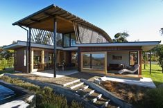 Tennent + Brown Architects designed this house for a family in Ngunguru, New Zealand.