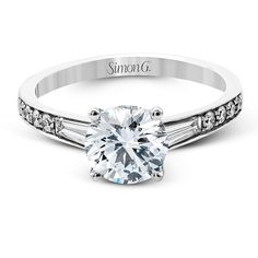 Engagement ring by Simon G. featuring round-cut diamonds highlighted by tapered baguette-cut side diamonds.