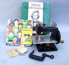 "Black Singer Model 20-10 ""SewHandy"" Toy Sewing Machine in the Box This 1950's example"