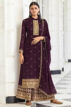 Bright and colourful, this dark purple georgette sharara suit which will reflect the charm of high-end fashion. This closed neck and full sleeve party wear suit prettified with zari, thread and stone work. Matched with georgette sharara pants in dark purple color with dark purple georgette dupatta. Sharara pants has zari, stone and thread work. #shararasuits #malaysia #Indianwear #weddingwear #andaazfashion Sharara Suit, Salwar Kameez, Kurti, Indian Attire, Indian Ethnic Wear, Wedding Salwar Suits, Silk Lehenga, Anarkali Lehenga, Lehenga Suit