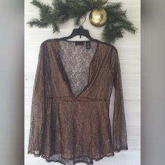 Lacey Top Brown/copper color shirt. Lacey. Pair this with black under shirt for a wow look :) new without tags. New York & Company Tops Blouses
