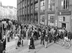 May 1932 - A mass gathering of the unemployed outside a government-run job office in Berlin. Such gatherings sometimes led to street riots.