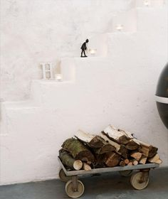 movable wood storage for the hallway or porch.