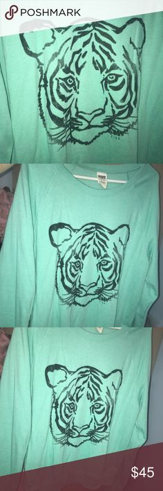Vs pink graphic tiger sweatshirt M Cute rare to find graphic tiger aqua sweatshirt vs pink size M with the word pink on the back. Worn twice and it's  to big on me now PINK Victoria's Secret Tops Sweatshirts & Hoodies