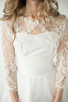 LOVE tis lace bolero over a simple strapless wedding dress...Leigh bolero