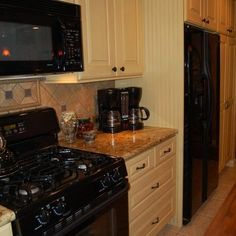 Enclosing A Free Standing Refrigerator ~ The tall bead board panels are deeper than the cabinets to make the free standing refrigerator appear as if it is built in ~ Photo by Laurie Burke ~ Beaded Board Panels Design, Pictures, Remodel, Decor and Ideas