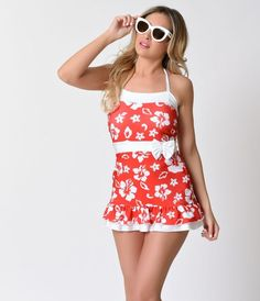 A vintage necessity, the Leani retro halter bathing suit from Lolita Girl is nothing short of striking! A vintage 1950s inspired red and white Hawaiian floral swimdress, with white contrast color blocking for a nipped in silhouette that's universally fla