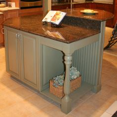 Kitchen island with beadboard, decorative leg and two levels