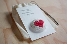 This cross stitch heart pin is the perfect token to give your loves this Valentine's Day. Each pin is hand stitched in the cozy brick house, attached to a card with a favorite E.E. Cummings quote, and packaged sweetly in a muslin bag.