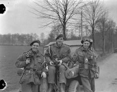 Photograph of three photographers of the Canadian Army Film and Photo Unit attached to the 1st Canadian Parachute Battalion. Wissel, Germany, March 27, 1945. [Uncle Albert Hanning Calder in the middle. NT]