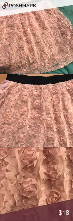 Forever 21 Pink Lace Chiffon Rosette Skirt Large Forever 21 Pink Lace Chiffon Rosette Skirt. Lacey pink fabric makes up small pink roses with black elastic waistband. A-Line, not a mini but falls slightly above knees. Very stretchy, lined. Forever 21 Skirts