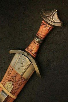 The weapon that all the Viking warriors desired to have once in their lifetime was the Viking sword. It was not only because Viking sword was deadly and powerful but it also represented the high status of its wielder in the society. Swords And Daggers, Knives And Swords, Larp, Viking Life, Viking Symbols, Viking Runes, Templer, Medieval Weapons, Norse Vikings