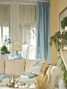 This otherwise neutral living room benefits from a hint of dressiness with curtains of soft blue raw silk. To invite cuddling up, use white slipcovers in soft, easy fabrics, like the brushed cotton on this sofa in the den, and layer on pillows and throws. Yellow Walls, Room Design, Blue Living Room, Curtains Living, Blue Curtains Living Room, Home Decor, Room Inspiration, Blue Living Room Decor, Yellow Living Room