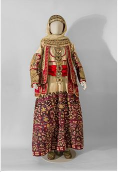 BRIDAL COSTUME With a long cotton chemise richly adorned with silk and gold embroideries. Attica. Cotton, silk thread, metal thread, wool, felt, velvet. 19th c.