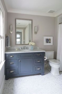 I love these navy cabinets!Navy cabinet paint color is Benjamin Moore French Beret Wall paint color is Farrow and Ball Cornforth White Floors are Circle Polished White Statuary Calacatta Marble. Martha O'Hara Interiors. Cabinet Paint Colors, Wall Paint Colors, Paint Tiles, Blue Gray Paint Colors, Color Beige, Trim Color, Bad Inspiration, Bathroom Inspiration, Bathroom Ideas