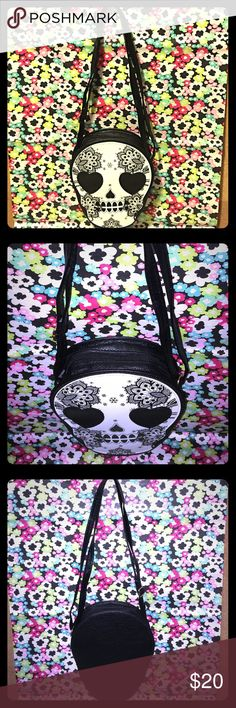 """Day of the Dead Skull Head Cross Body Handbag ~New This is a brand new item for sale. DAY OF THE DEAD SKULL HEAD CROSS BODY HANDBAG. Made of a faux Leather material Gold Hardware Accents Top Zipper Closure and Adjustable Strap Drop to make it into a Shoulder Bag or Cross Body. The measurements are Height 8"""" Length 6.5"""" Depth 4.5"""" Strap Drop 47"""" Adjustable. Extremely Funky Chic Handbag. Thank you for looking. N/A Bags Crossbody Bags"""