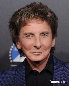 Singer Barry Manilow arrives at the 2nd Annual Rebels With A Cause Gala at Paramount Studios on March 20, 2014 in Hollywood, California.  (Photo by Axelle/Bauer-Griffin/FilmMagic)