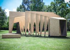 Dream Pavilion by IPT Architects- Made from sheets of oriented strand board (OSB) – a kind of engineered chipboard – and untreated mild steel, the freestanding sections frame a pathway through the centre of the structure.