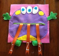 Monster quiet book page with zipper mouth and counting tongues I just finished for my one year old.