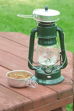 Lehman's - Dietz Oil Lantern Cooker..awesome have light and a cup of hot coffee as well.