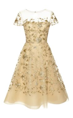 "This gold embellished tulle dress by Oscar de la Renta lends itself to a cocktail party version of the pink dress Liesl wore in ""The Sound of Music"""