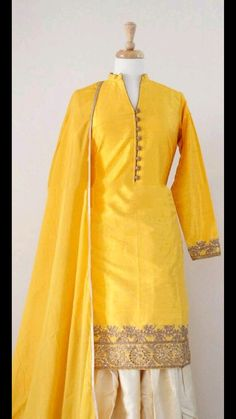 Graceful Party Wear Yellow Suit in Raw Silk