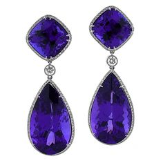 "Breathtaking combination of 58.44 carats of the finest Tanzanite gemstones. Perfectly matched, these Tanzanites are large and the finest of Tanzanite colors. If you can break your gaze from the ""firey"" violet blue gems, you can appreciate the stunning handmade Platinum and Diamond earrings. Congrats fourtane.com"