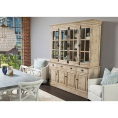 This distressed hutch cabinet is the perfect vintage piece to add a unique flair to any room. The rustic hutch cabinet has four doors, four drawers, and six sturdy shelves, allowing for ample storage
