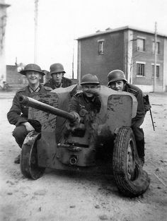 German soldiers pose with British and French captured material, France 40
