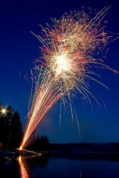 Light; Flare: sudden light burst. The streaking bright light of the fireworks flare up in an explosion at the top.