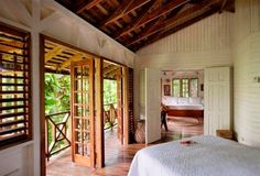 Deep in Jamaica's rainforest, Kanopi House hotel is the place to fulfill fantasies of sky-high treehouse living, surrounded by cloud-sweeping, vine-entangled banyan trees. Jungle House, Forest House, Tropical Architecture, Architecture Design, Treehouse Living, Bamboo House Design, Italian Home Decor, House Shutters, Hawaii Homes