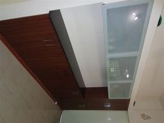 these is working platform opposite  kitchen area  or you can call it try space for kitchen , microwave,and small electronic  mixers can be keep on granite top above it is  acid glass with  spacewood company profile   lid stay fitting  , plz call up for free esitmata in baroda city    or whatzup your pic of old or new kitchen   on 9824083905   or visit our website  www.enconsindia.com