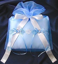 Ring pillow wrapped in blue organdy