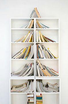 "Cute way to arrange books on your bookshelf to look like a christmas tree - I wonder if the ""elves"" would do things like this?  ;o)"