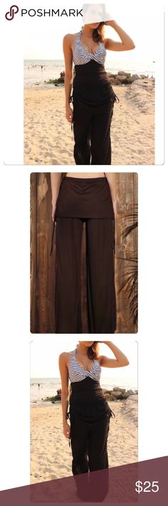 20% Bundles‼️‼️ Gorgeous comfortable pants for the summer. The model is wearing a tube top which makes it look like one outfit. Photo two will show you that they are just pants but these are black like the model is wearing. You can wear it with a top to make it look like a one piece or with a loose top for a two piece look. These pants are so comfy and they have draw strings on the side if you want that look. Prices are firm unless bundled✅ Pants Track Pants & Joggers